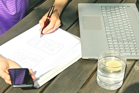 work from home: work from home, freelance designer drawing mobile application wireframe