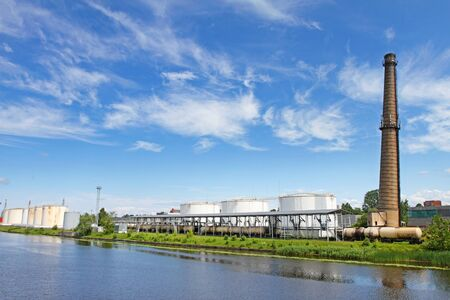 terminals: oil terminal near river in sunny day Stock Photo