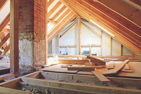 insulating: an interior view of a house attic under construction