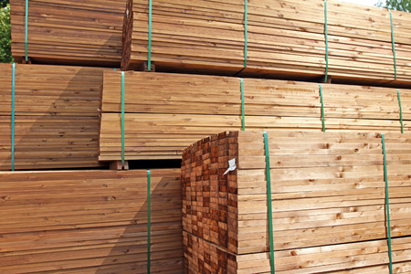 lumber industry: stack of wooden terrace planks at the lumber yard Stock Photo