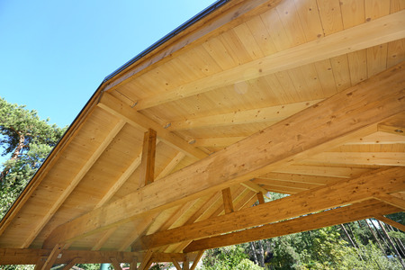 rafters: wooden roof construction of outdoor carport Stock Photo