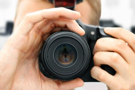 slr camera: front view of man holding camera. closeup Stock Photo