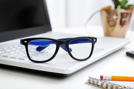 workspace with hipster glasses on laptop Stock Photo