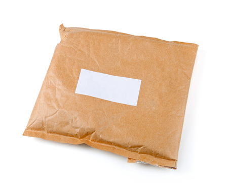 small paper: small paper post parcel with blank label isolated on white Stock Photo