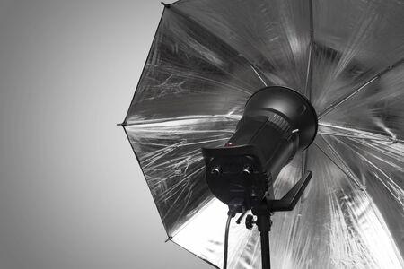 strobe: photography studio strobe flash with silver umbrella and gray copy space