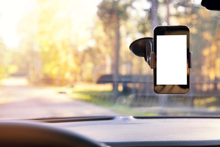 holders: mobile phone with blank screen in car windshield holder Stock Photo