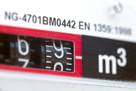 natural gas prices: macro shot of gas meter numbers