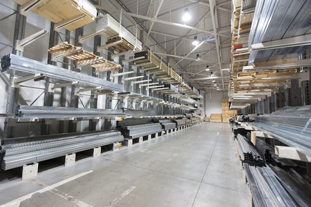 construction material warehouse, shelves with aluminum profiles Stock Photo