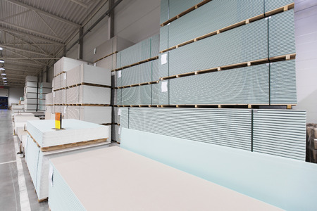 plasterboard: warehouse with piles of construction plasterboard