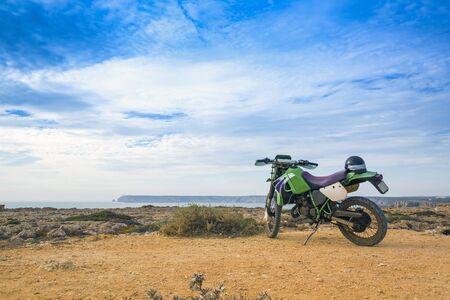 enduro: enduro motorbike on the rock in Sagres, Portugal