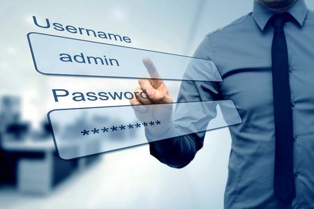 Casella di accesso - dito spingendo campi username e password Archivio Fotografico - 48482579