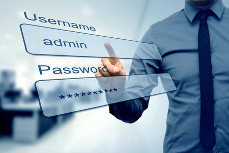 login box - finger pushing username and password fields Фото со стока - 48482579