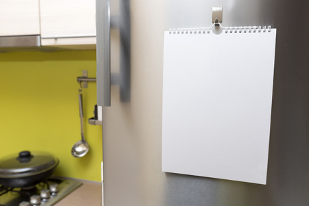 refrigerator kitchen: blank paper sheet hanging on fridge door