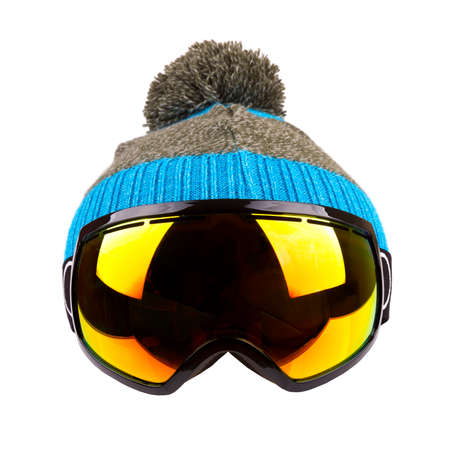 ski goggles: ski goggles and woolen hat isolated on white