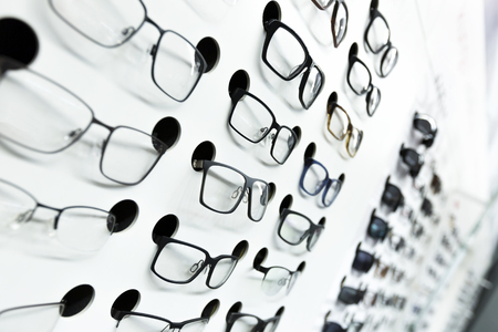 optical: optical store, wall of many fashionable eyeglasses