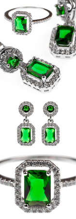 green emerald jewelry, ring and earrings isolated on white