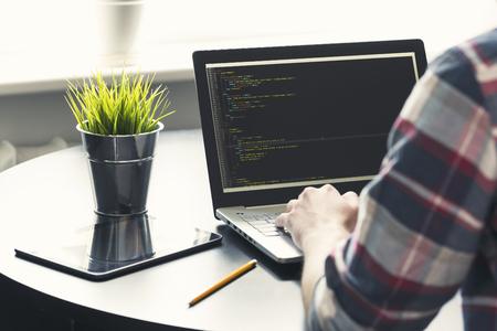 programmer working on laptop at office. focus on programming code Stockfoto