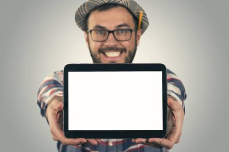blank screen: young happy attractive man showing blank digital tablet Stock Photo