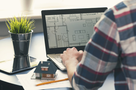 architect, interior designer occupation - man working on new house project at office Foto de archivo