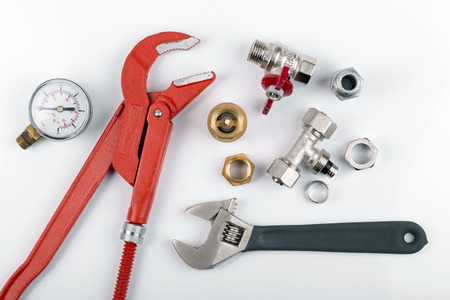 plumbing accessories: plumbing tools and equipment isolated on white
