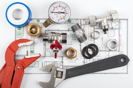 plumbing accessories: plumbing tools and equipment on blueprint