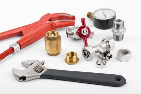 plumbing accessories: plumber tools and equipment on white background Stock Photo