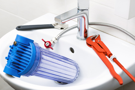 plumber equipment and water filter in the sink