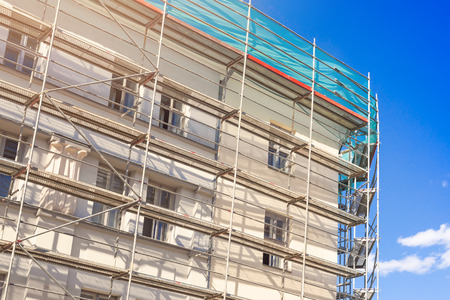 house exterior with scaffold - old town building facade restoration