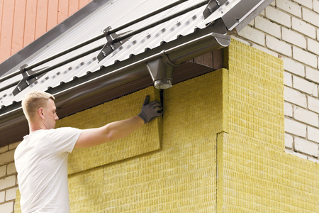 rock wool: house insulation - insulating house facade with mineral rock wool