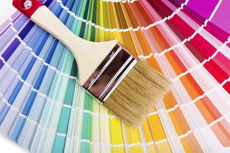 samples: catalog with paint color samples and brush