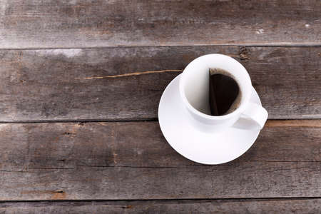 half: half cup of coffee on wooden table with copysace