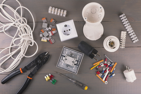 electrical tools and accessories on wooden table Stockfoto