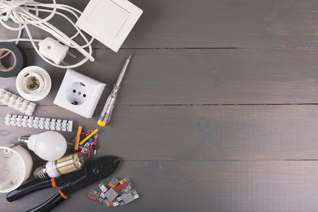 voltage gray: electrical tools and equipment on wooden table with copy space