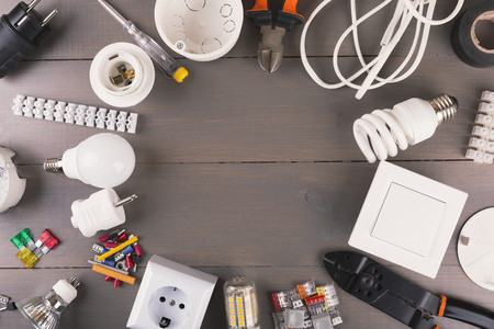 top view of electrical tools and equipment on wooden table Stockfoto