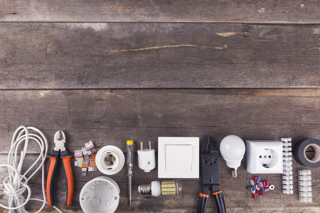 electrical tools and equipment on wooden background with copy space Zdjęcie Seryjne