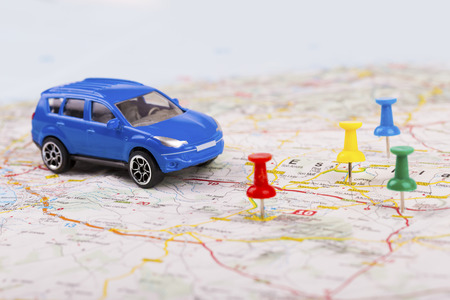 road trip concept, car with destination points on map Stock Photo