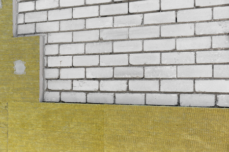 insulate: insulating house exterior with mineral rock wool Stock Photo