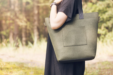 khaki color felt bag on womans shoulder