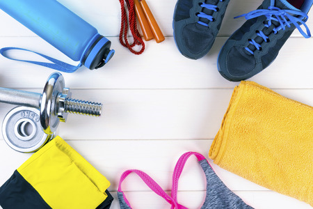 top view with fitness equipment on white wooden background