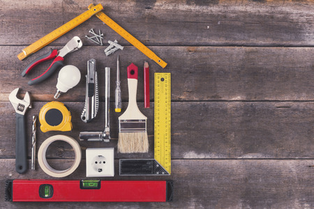 renovation house: house renovation and improvement DIY tools on old wooden background