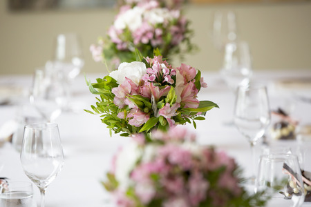 romantic places: wedding banquet table flower decoration in a restaurant