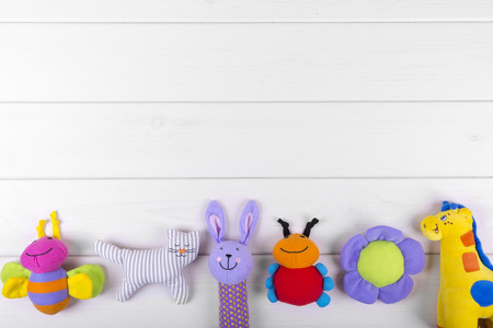 stuffed toys: stuffed baby toys on wooden background with copy space Stock Photo
