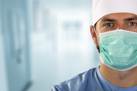 doctor surgeon with face mask standing in the hospital hallway Standard-Bild