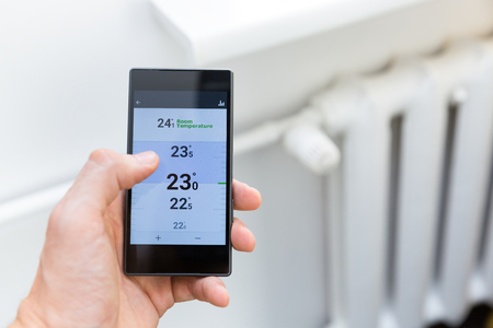 modern house heating temperature control system with smart phone Foto de archivo