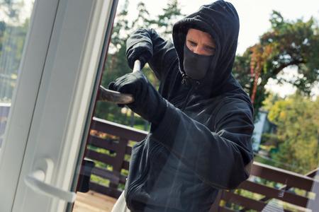 opens: house robbery - burglar opens balcony doors with crowbar