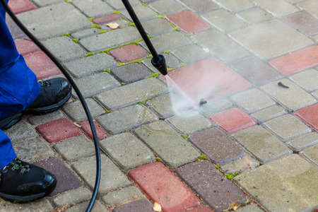 pavement cleaning with high pressure washer Фото со стока - 66945212