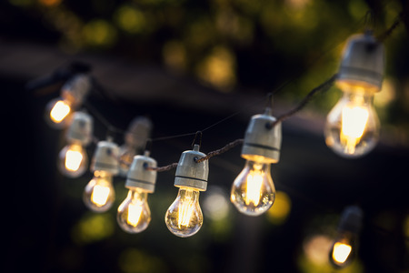 outdoor event: party string lights hanging in a line Stock Photo