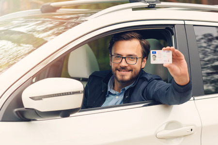 young happy man showing his new driver license Stock Photo