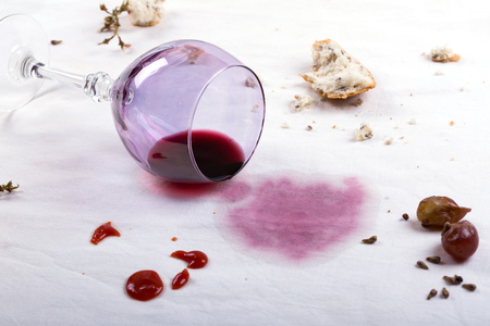 stains on tablecloth of spilled wine glass and food