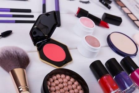 cosmetics products: collection of makeup cosmetics products on wooden table Stock Photo